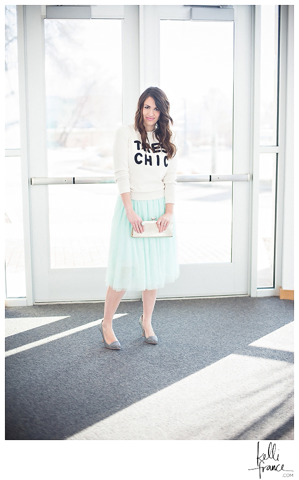 Tres Chic knit sweater, tulle skirt, black and white pumps