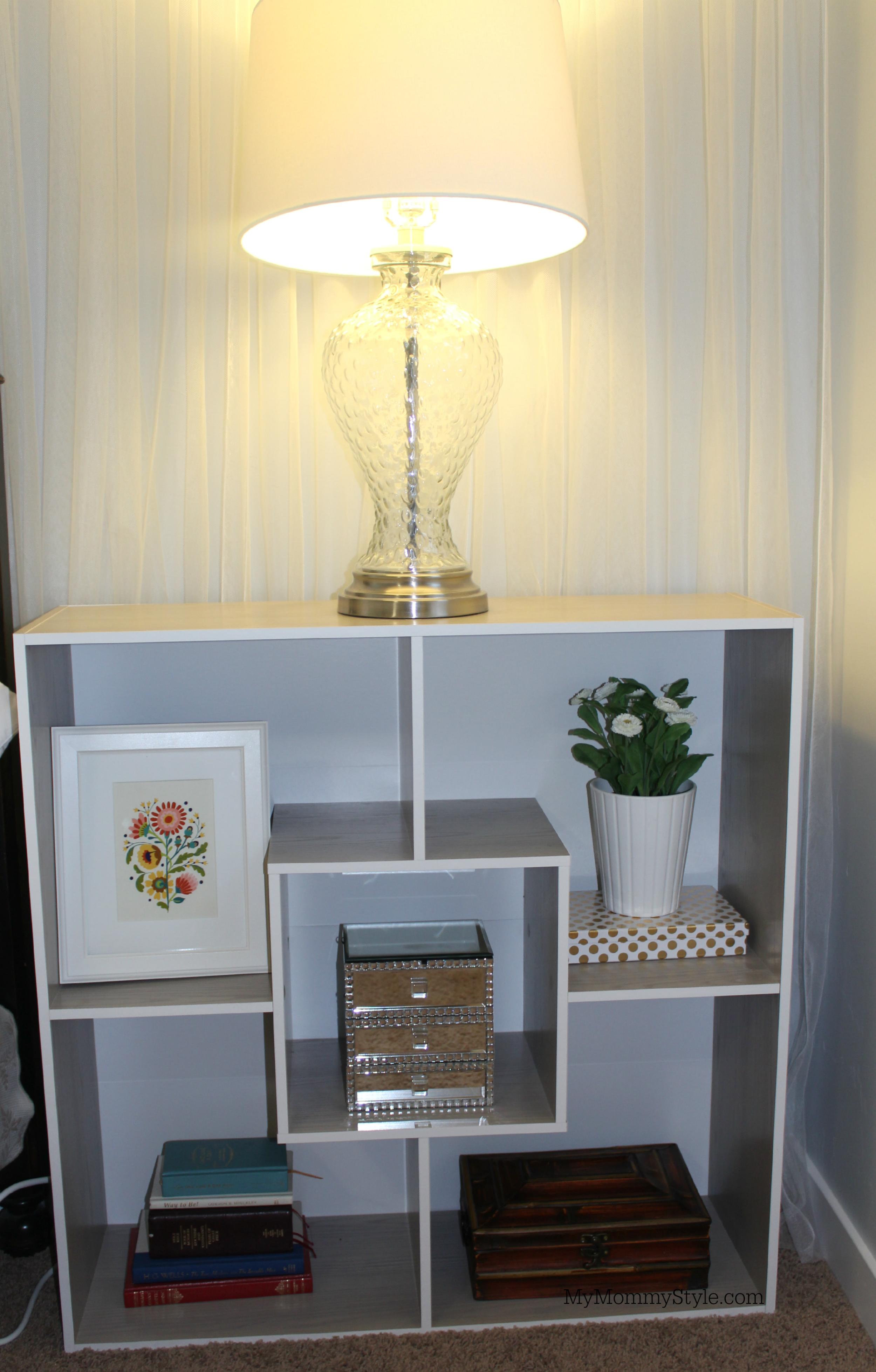 Bookshelf nightstand with feminine decor
