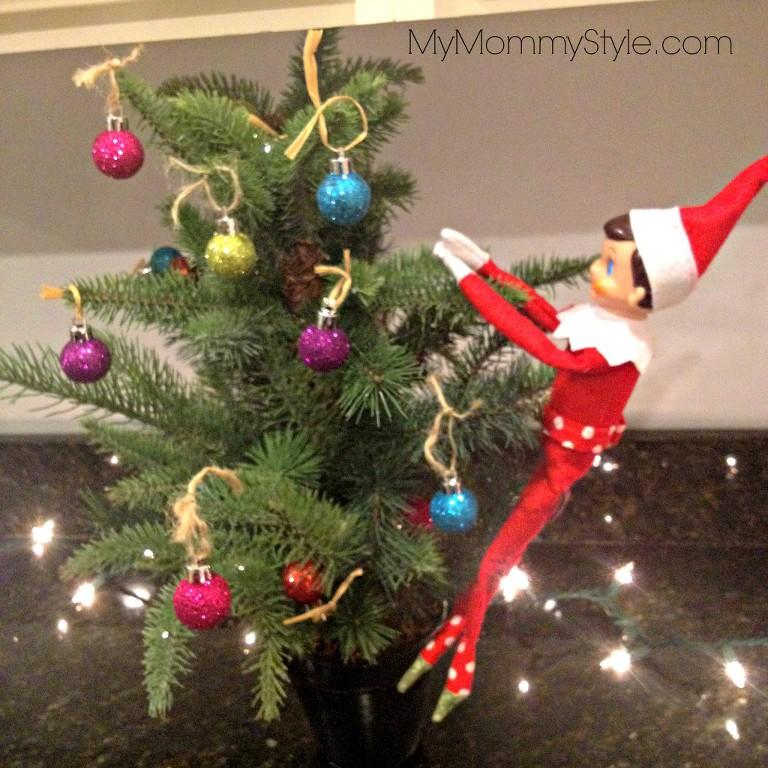 elf on the shelf ideas, elf decorating a tree