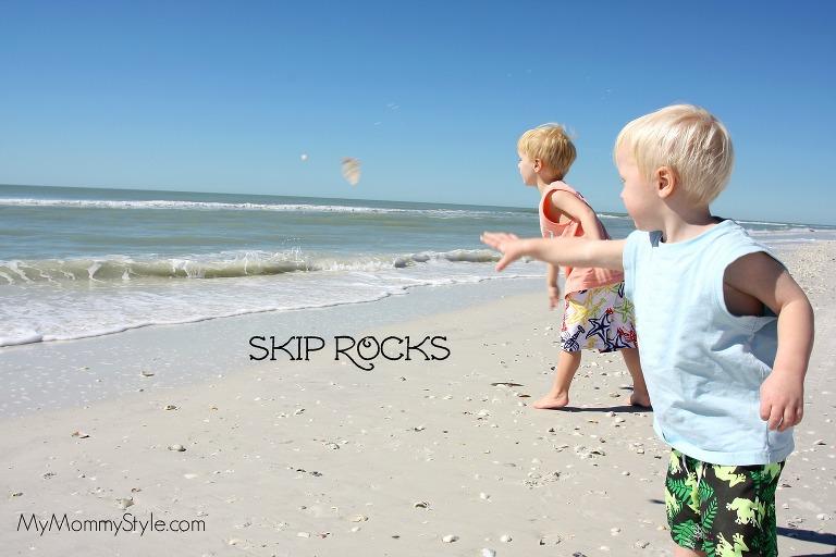 kids skipping rocks on the beach