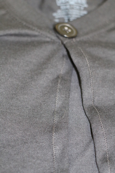 Close up of the zigzag stitch of the black Harry Potter Robe.