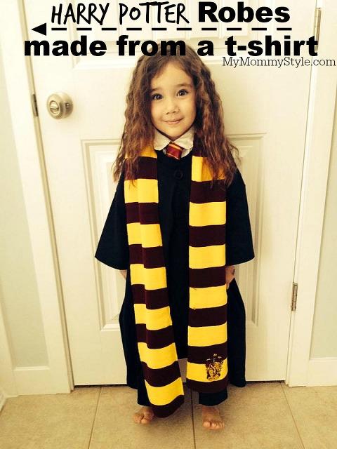Little girl wearing Harry Potter Robe Costume.
