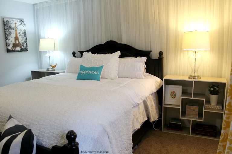 Side view of master bedroom with bookshelf nightstand
