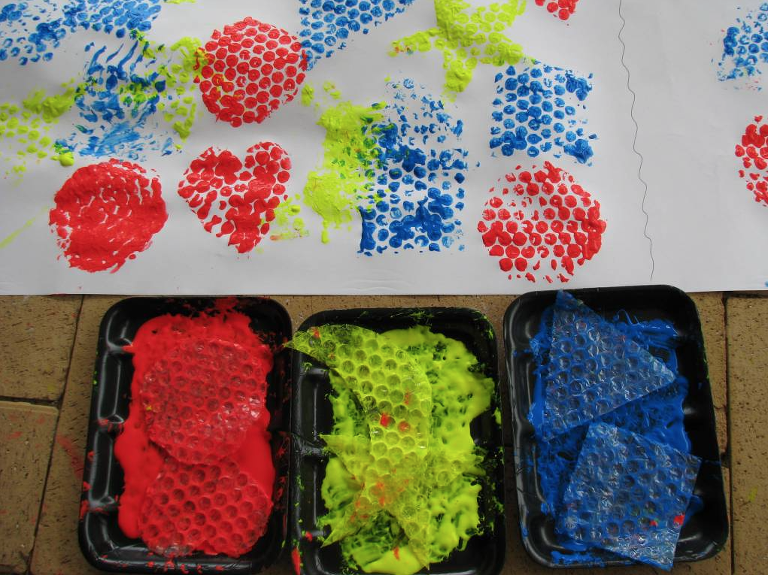 Bubble Wrap Art of shapes in red, blue and yellow.