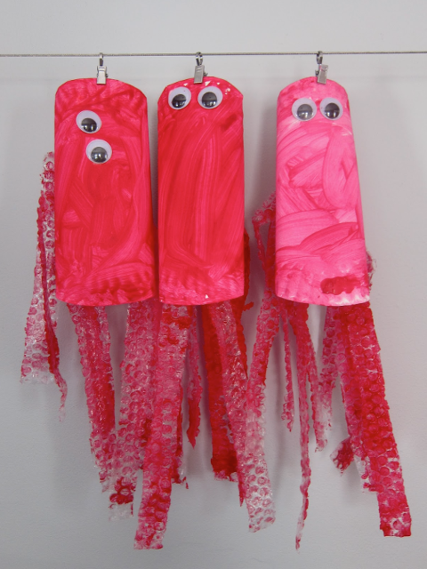 Bubble Wrap Art of pink and red octopus.