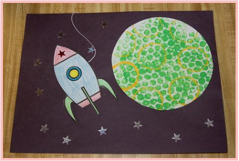 Bubble wrap art of rocket and moon.