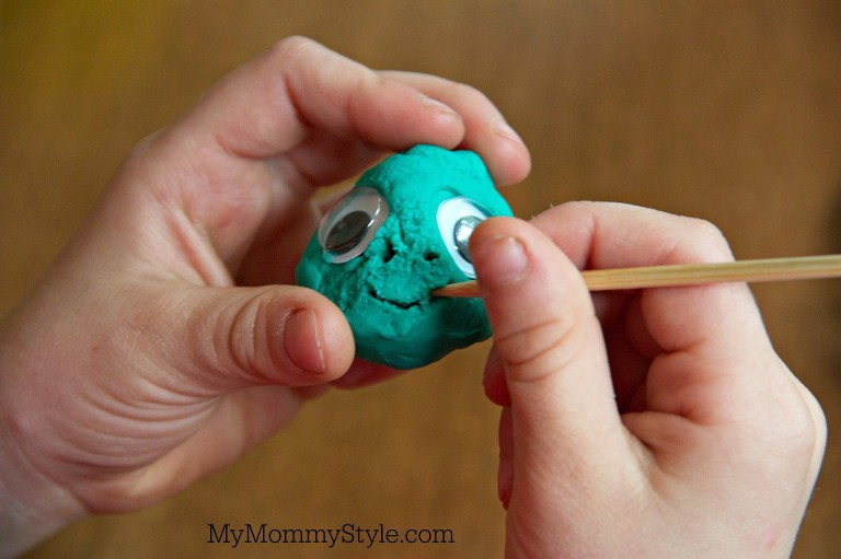 play doh skewer carving a face