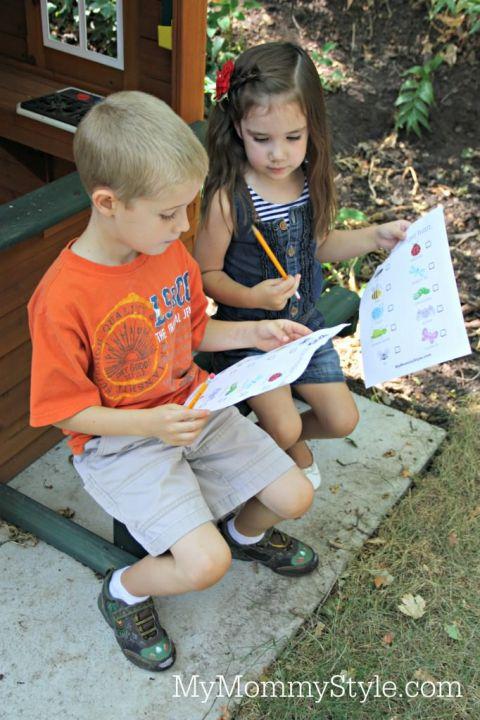 Kids doing bug scavenger hunt
