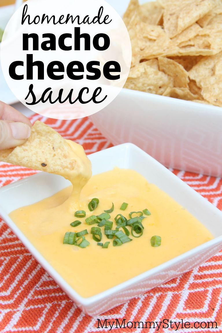 Bowl of homemade nacho cheese sauce with tortilla chips.