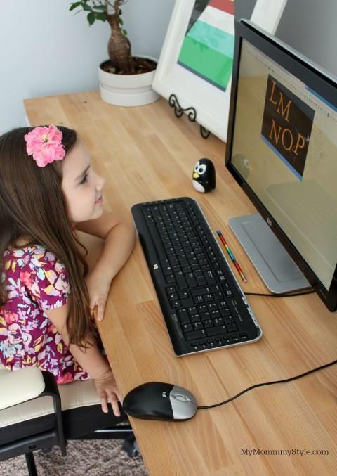 Child reading on computer Upstart Utah preschool