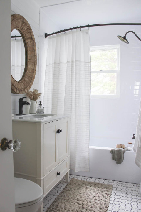 Chunky Mirror and Natural tones bathroom