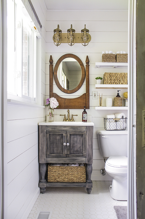 Shiplap Walls with Brass accent bathroom