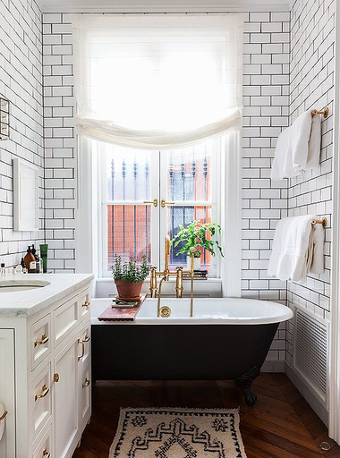 White Subway Tile Bathroom with Gold hardware.