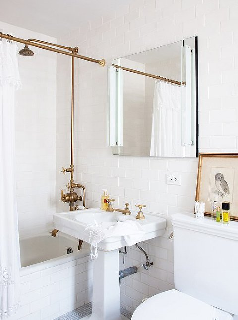 Simple Bathroom in White and Brass