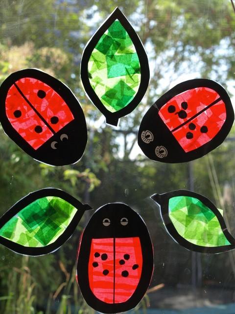 Ladybug sun catchers in a window.