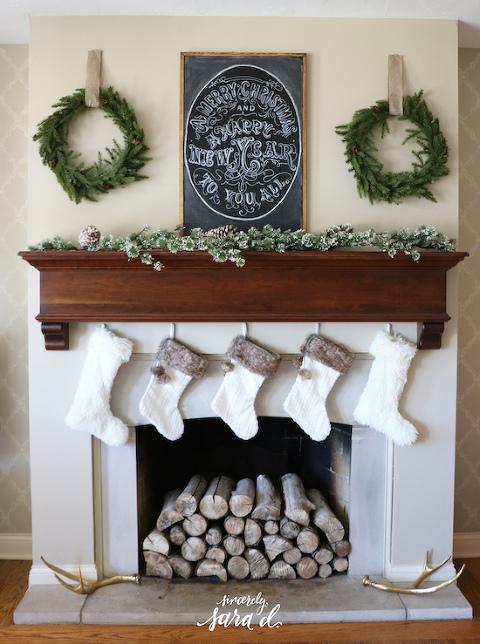 White stockings green wreath christmas-mantel