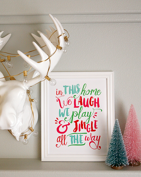 In this home we laugh we play & jingle all the way sign