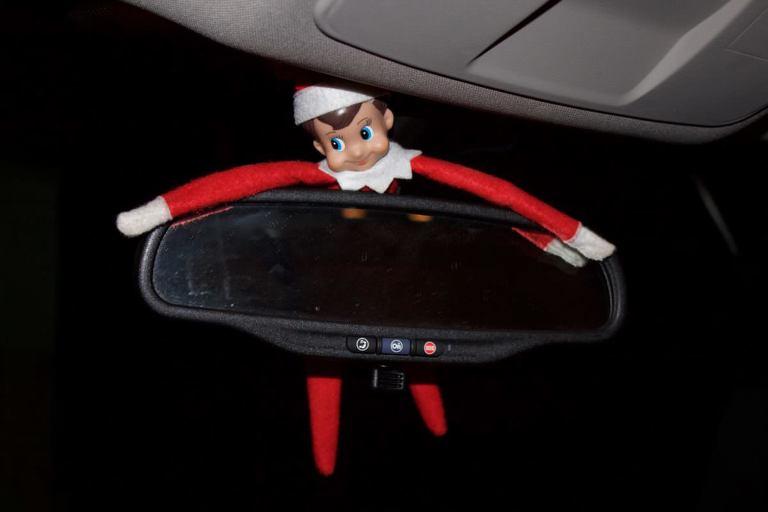 Elf on the Shelf in a Car Mirror