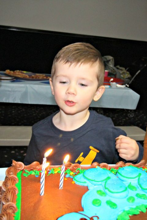 classic-skating-birthday-party-birthday-cake-blowing-out-the-candles