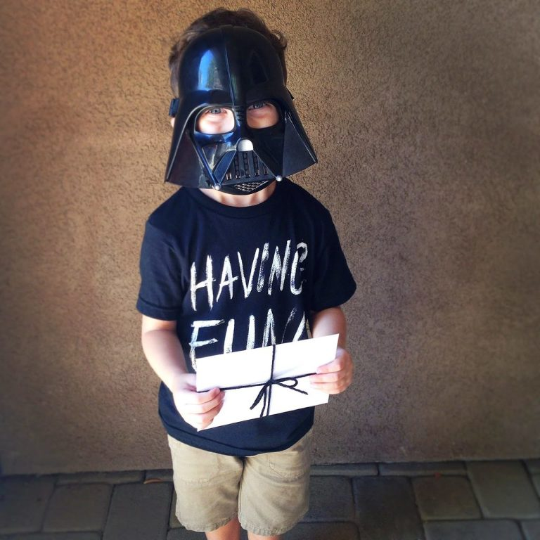 Boy wearing Darth Vader mask for Star Wars Birthday party invitations
