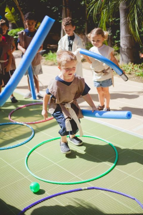 Kids running through hula hoops