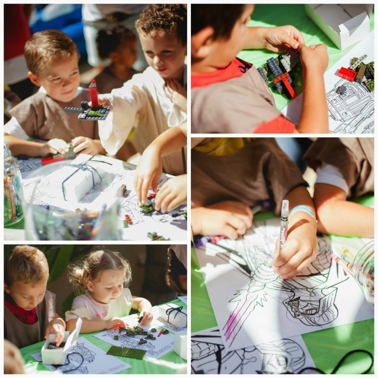 Kids completing Star Wars Build a fighter ship