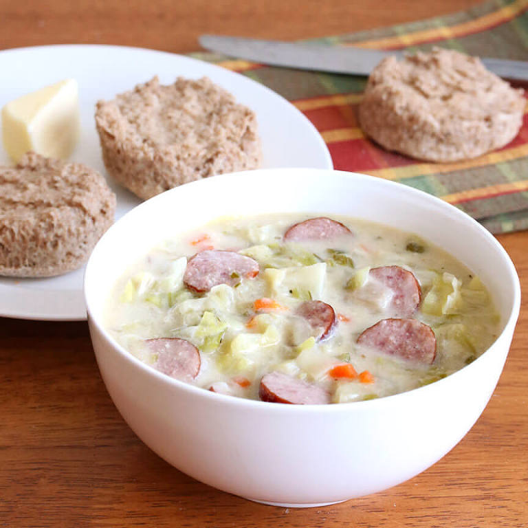 creamy cabbage and kielbasa soup in a bowl