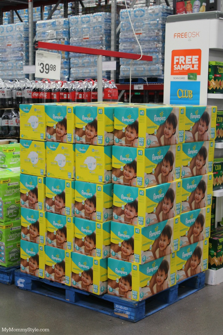 How Many Diapers do I need showing a stack of boxed Pampers Diapers.