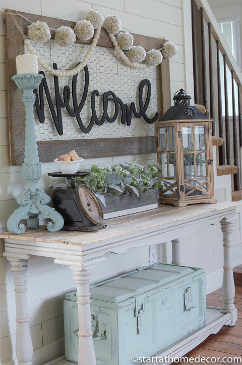 Entrance table with welcome sign above.