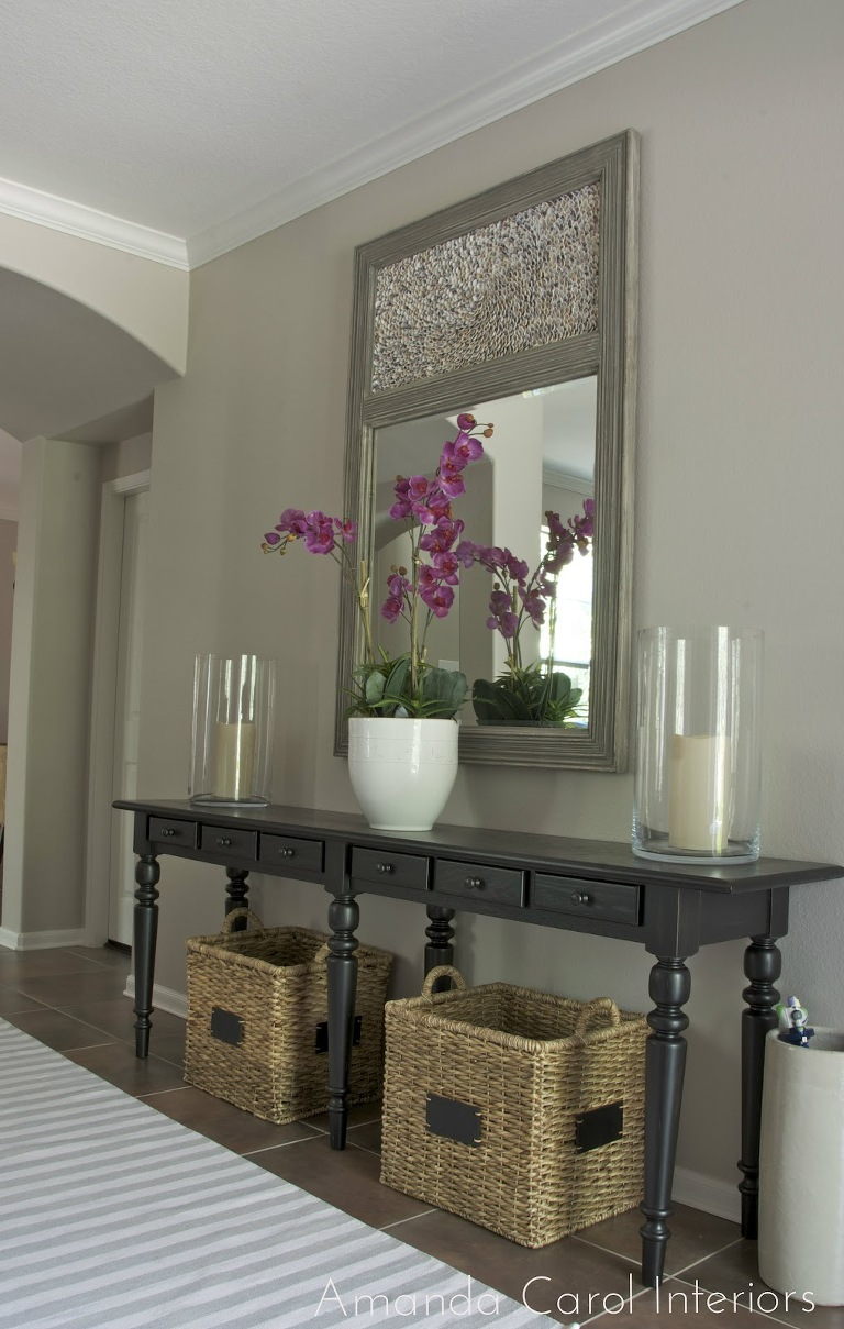 Dark wood entrance table with Large mirror above