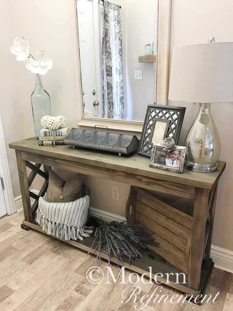 Entrance table with mirror above.