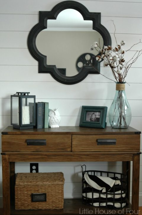 Entrance table with shiplap wall behind.