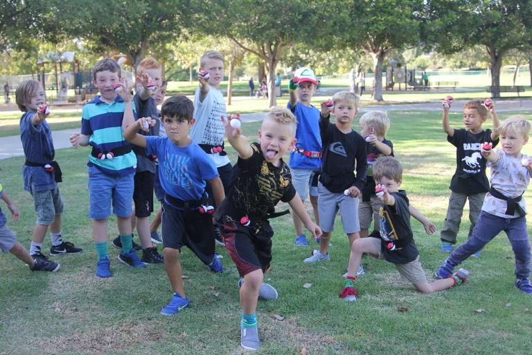 Kids showing their Poke Balls