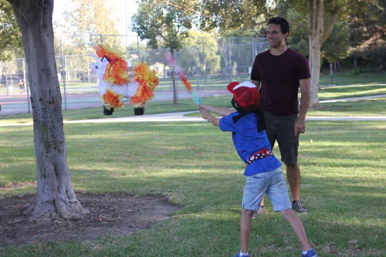 Boy hitting Pokemon piñata