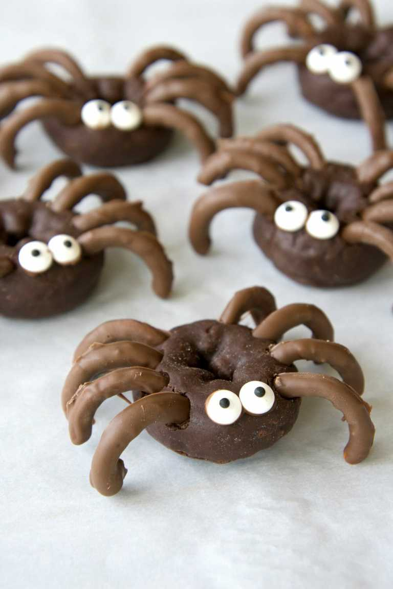 close up of chocolate spider Halloween donuts