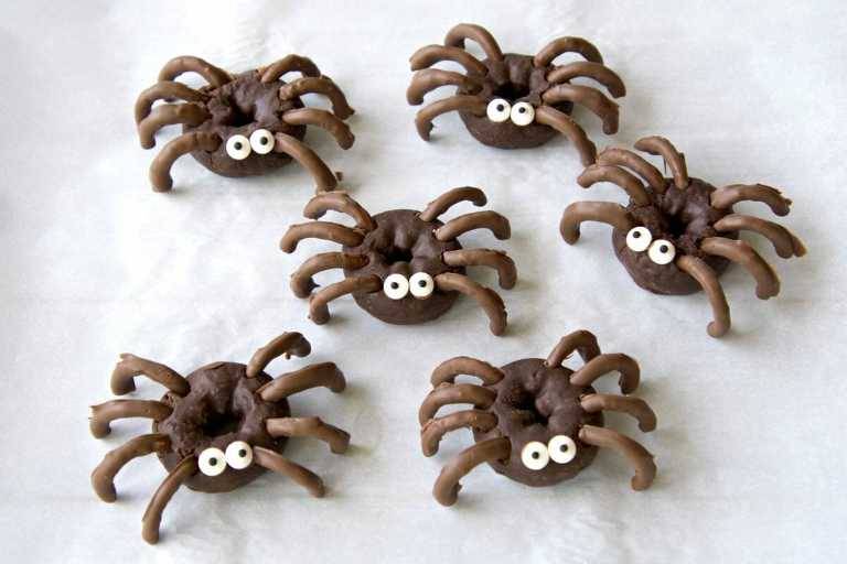 group of chocolate spider Halloween donuts