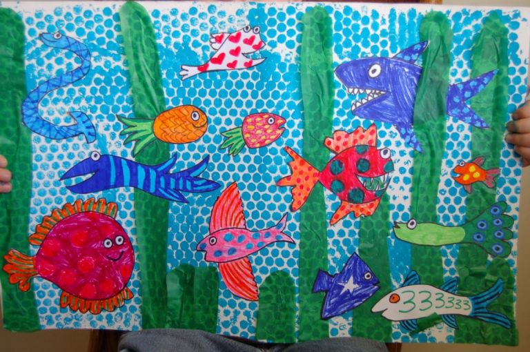 Bubble Wrap Art of Bright colored fish swimming in blue water.