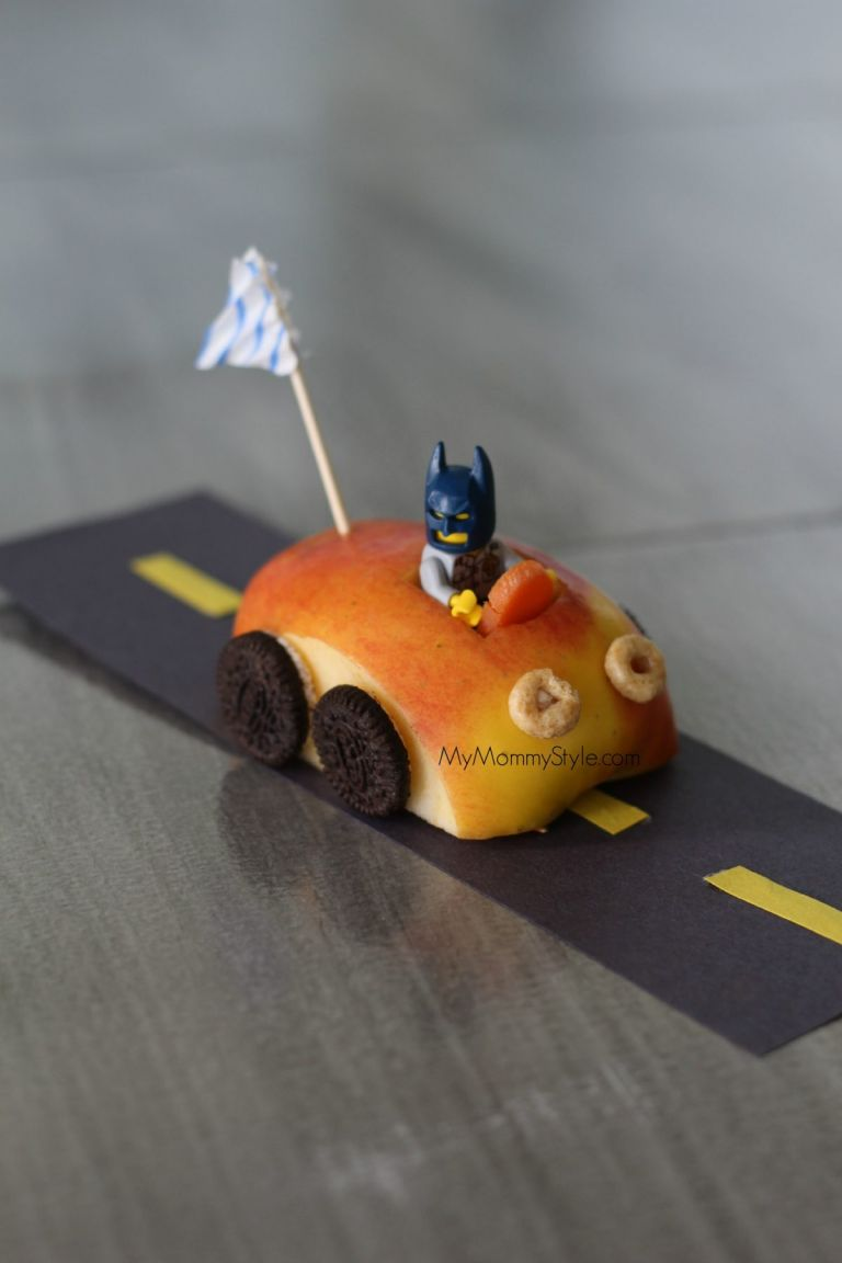 apple car with a batman figure inside.