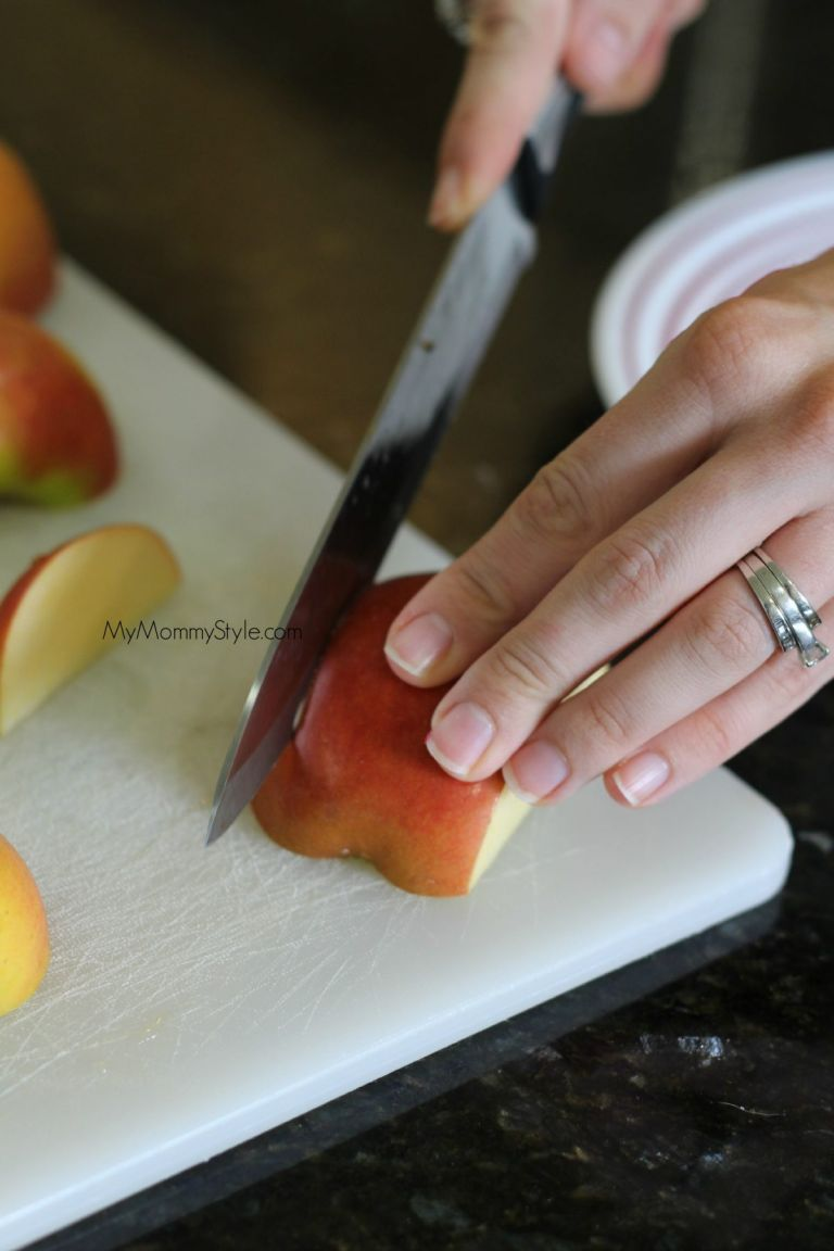 slices of the apple being cut with a knife.