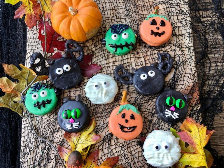 Halloween Oreos with pumpkins, cats, bats, ghosts and Frankenstein.