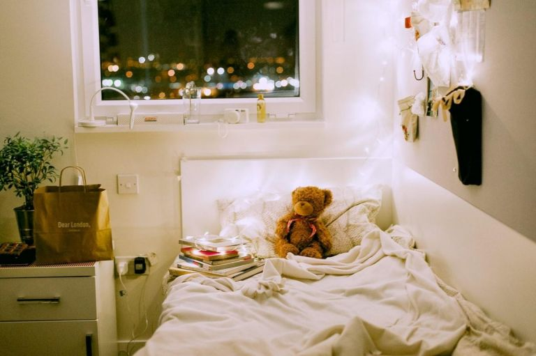 Bed with teddy bear